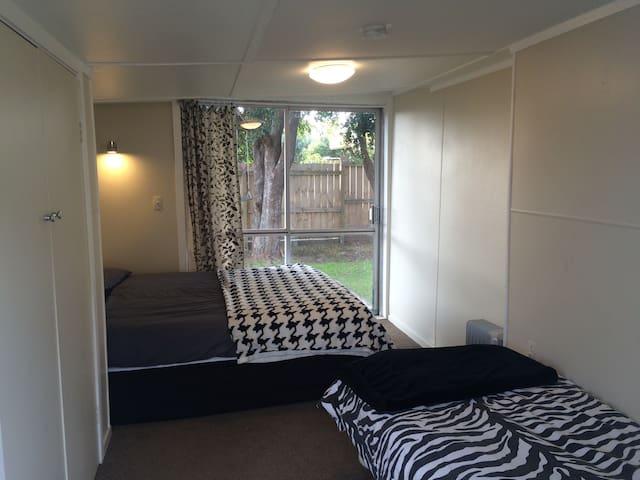The sleepout/third bedroom - queen + single bed