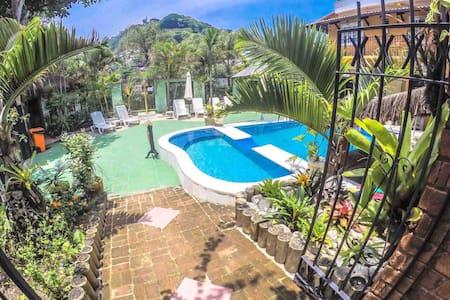 Corner room w/private patio & garden view - 214