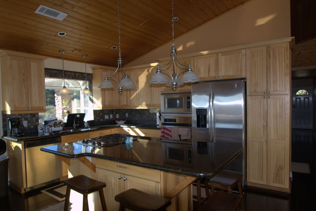 Kitchen adjacent to the family room, has everything you need to cook and have a great time.