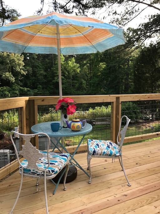 Bistro table on the deck for coffee by the pond