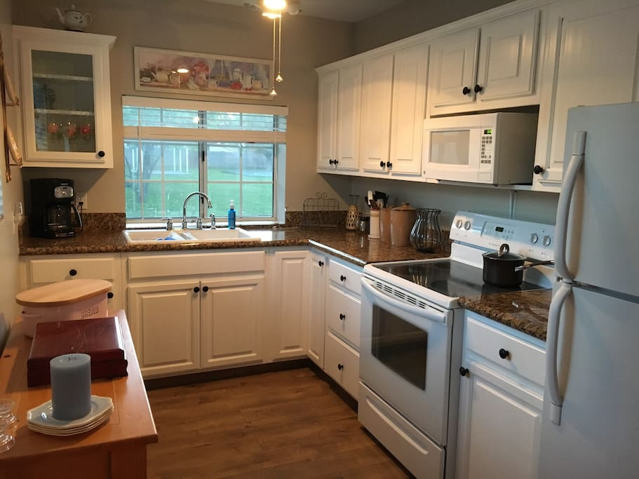 Fully stocked kitchen with coffee maker, pots and pans and any dishes you might need.