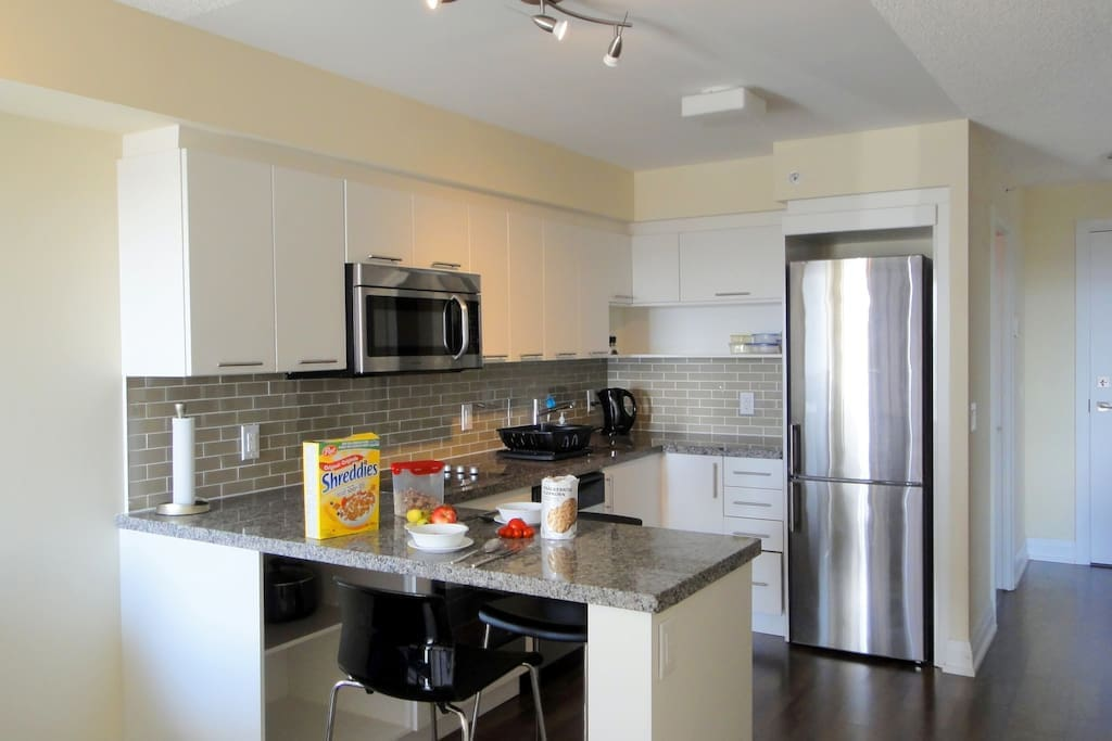 Modern kitchen with all appliances and utensils and breakfast island