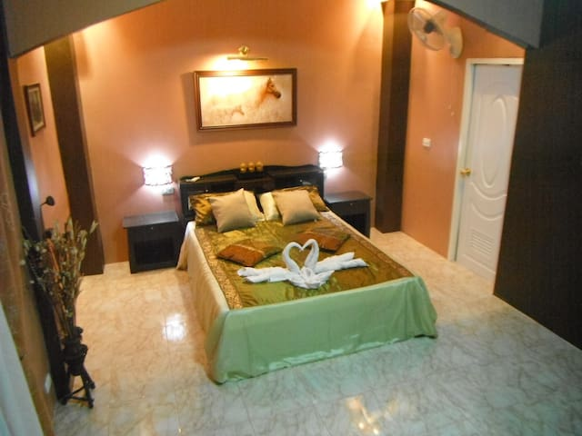 The romantic PARIS room,  on the 1 st floor, giving direct access to the large cool terrace.