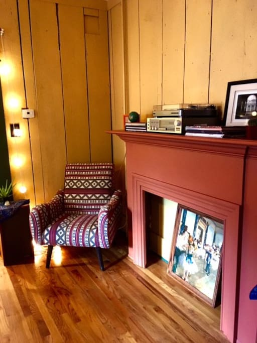 Dining room with record player on the mantle