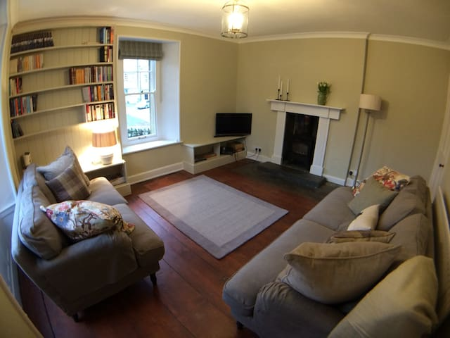 Spacious living room with log burner and open views