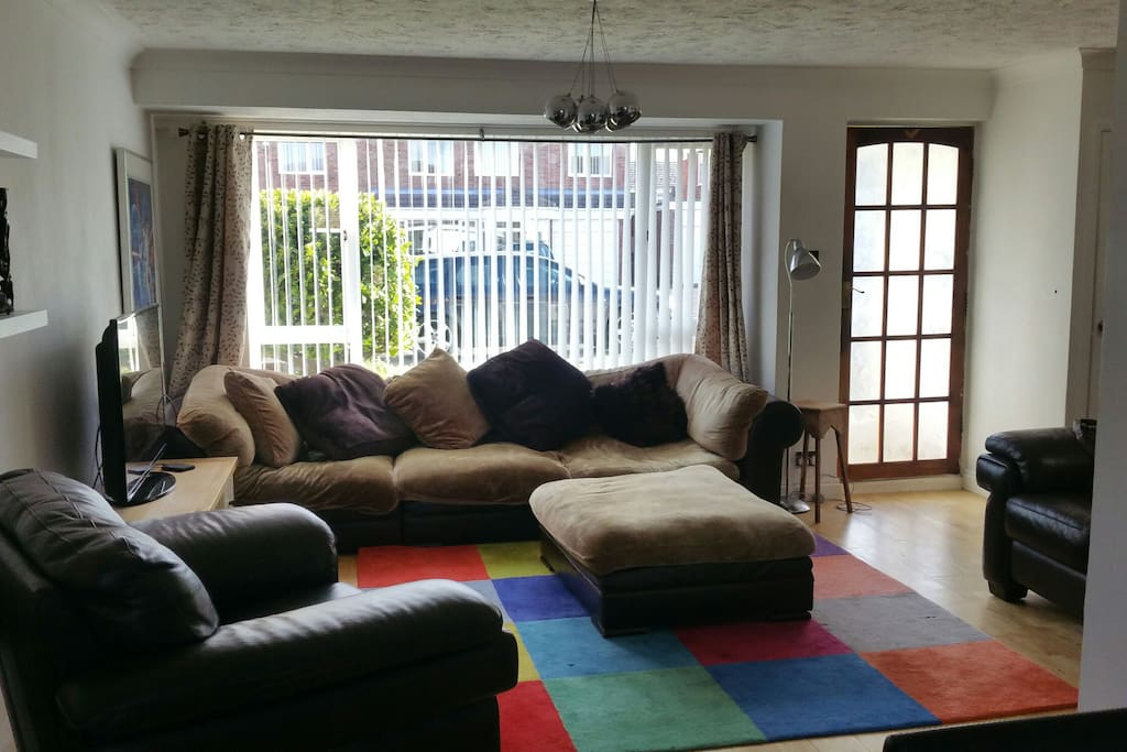 A light comfortable living area with plenty of sofas and a large tv with sky and free WiFi