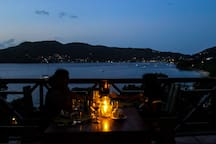 A candlelit dinner completes your day with the view from restaurant in the evening across the bay towards the harbour