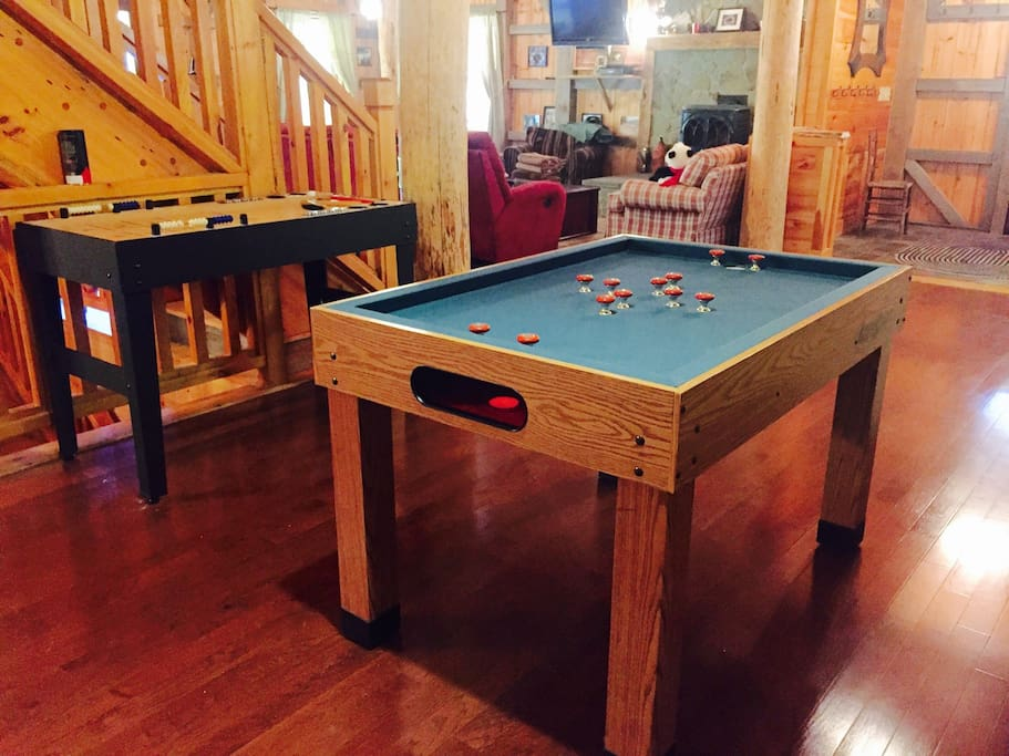Table shuffleboard and bumper pool in living space