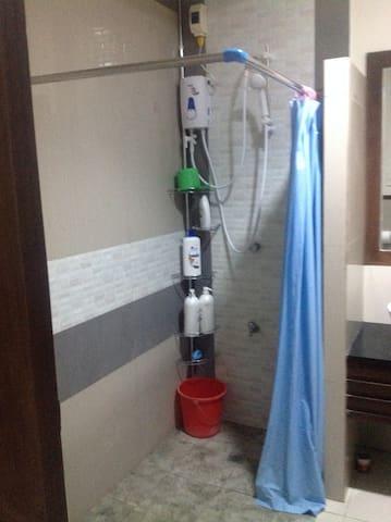 Bathroom with heated shower.