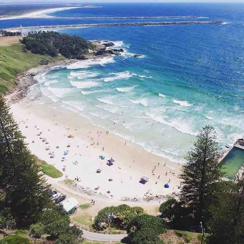 Main Beach.  Swim in the ocean, or the ocean pool.  Enjoy a tasty breakfast, coffee or grab an icy pole from The Kiosk.  No matter the weather it's almost always lovely down here.  This beach has lifeguards on duty in holiday periods.