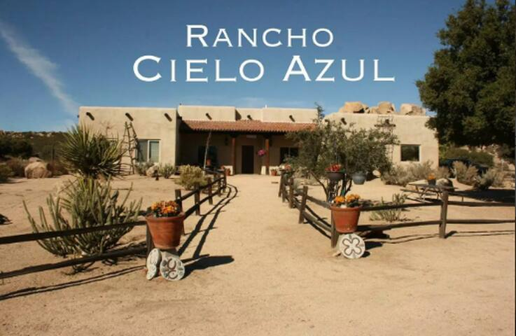 Front View of Rancho Cielo Azul, we are in a high desert setting with 50 acres of surrounding property. Beautiful rock formations and miles of blue sky.  Fantastic sunrises, sunsets, and peace and quiet.