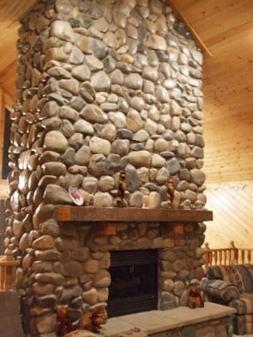 Amazing gas fireplace and stone chimney