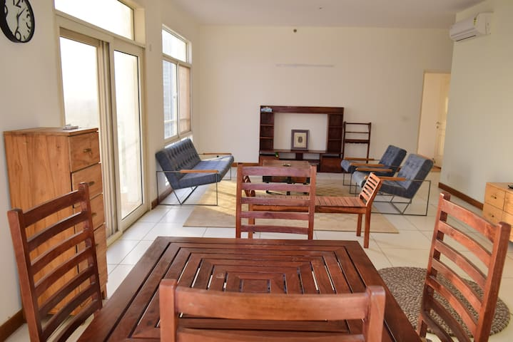 The spacious living room with glass view of indias best gold course