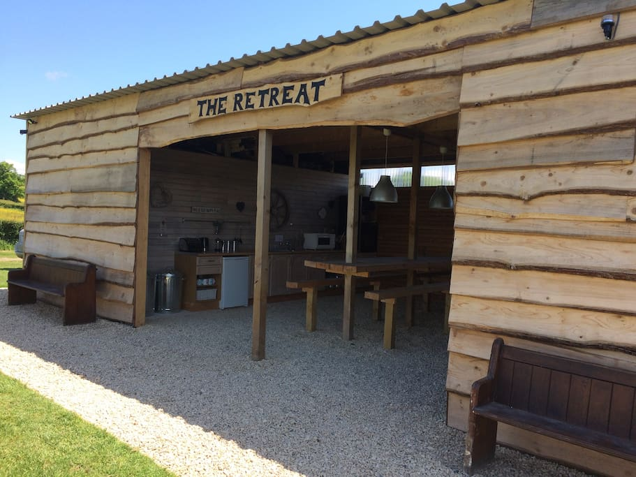 Our Log Retreat, with a fitted kitchen and warm showers and toilets.