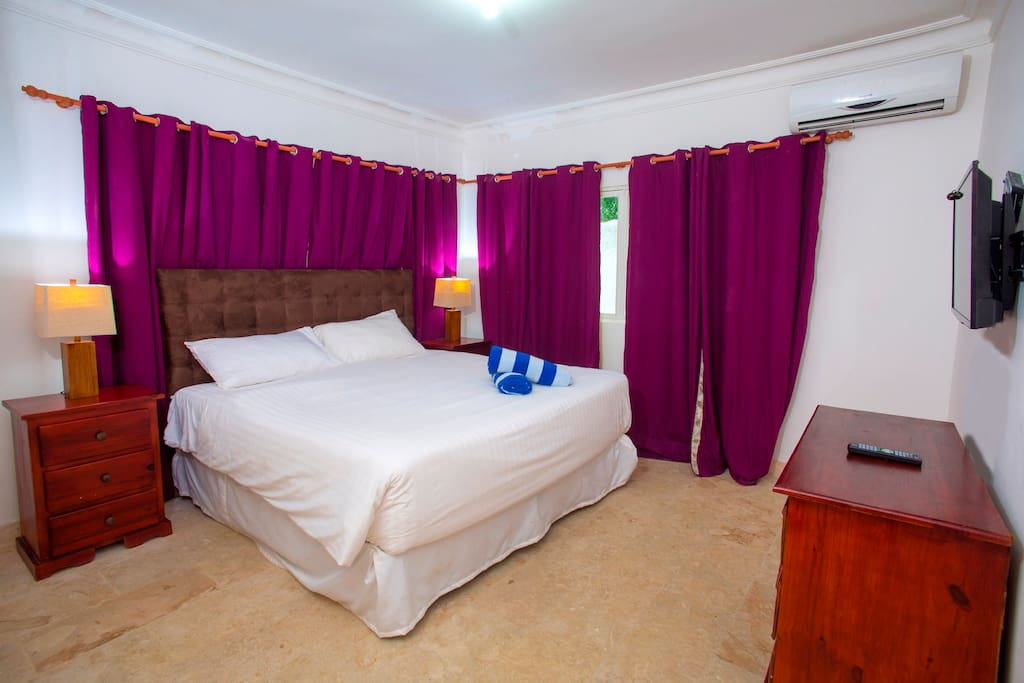 Your new bedroom with a full-king-size bed, nice dresser and night tables with lamps, it is made for your comfort and enjoyable vacation.