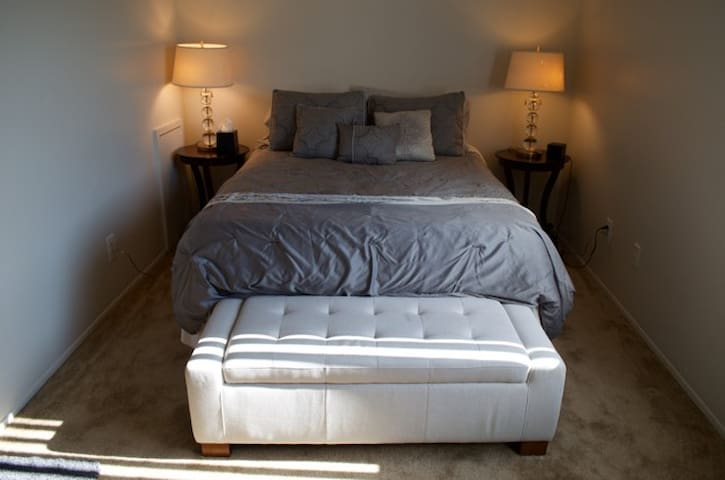 Master Bedroom with Cooling Gel Tempurpedic  Queen Size Bed and lots of pillows.