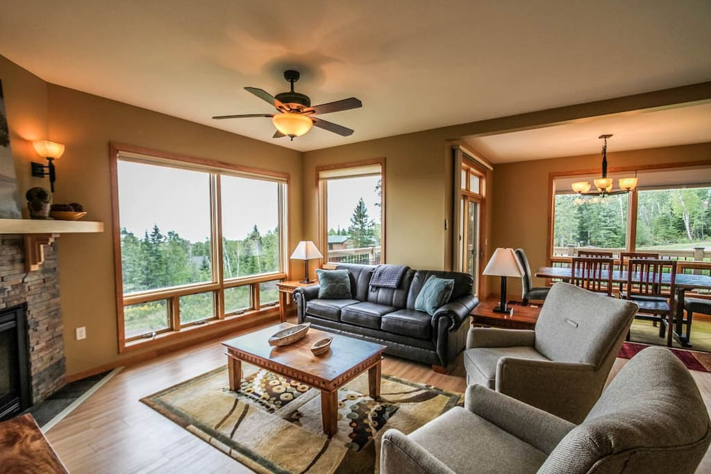 Nicely decorated living room with great views of Lake Superior.