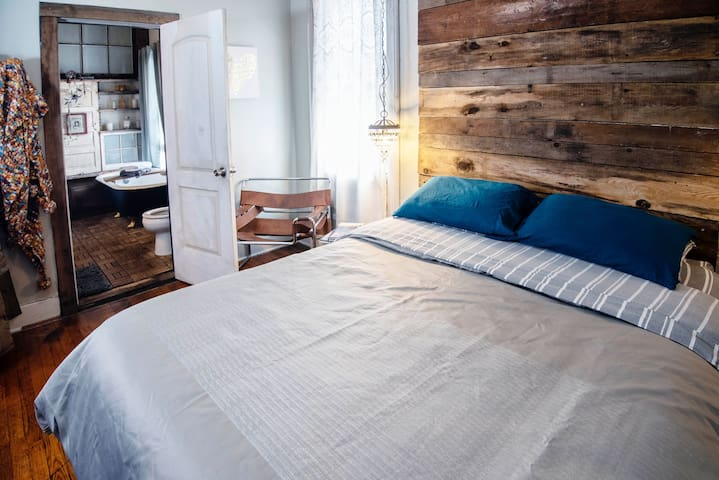 Main bedroom, queen bed, located on the first floor near the kitchen.