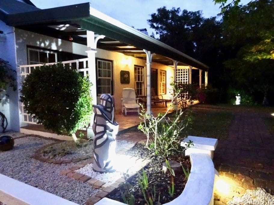 Sazzzman's Guestroom's Entrance with a lovely veranda & garden to enjoy at sunset.