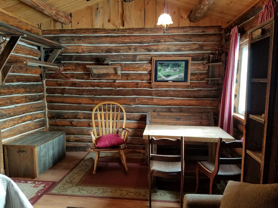 Cabin and furniture are hand-made from old barn wood