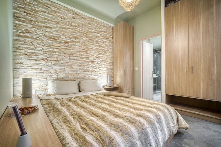Double bed - wardrobes - laggage storage - brick wall