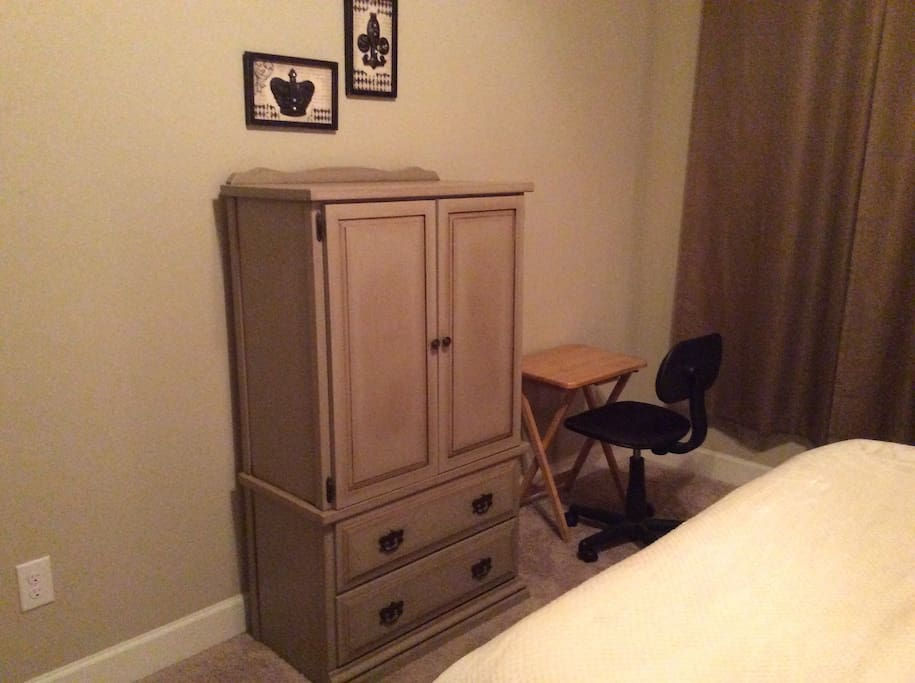 Unpack into this dresser and the hanging space in the closet. And the workstation is by the window.