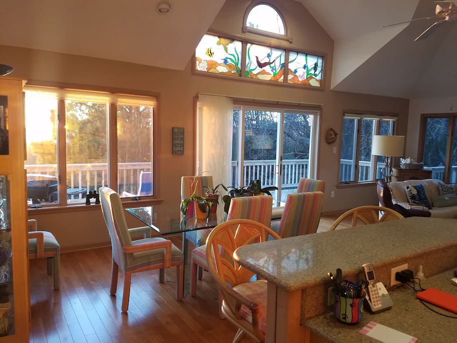 Very open room, table for 6, opens to kitchen and family room, top deck