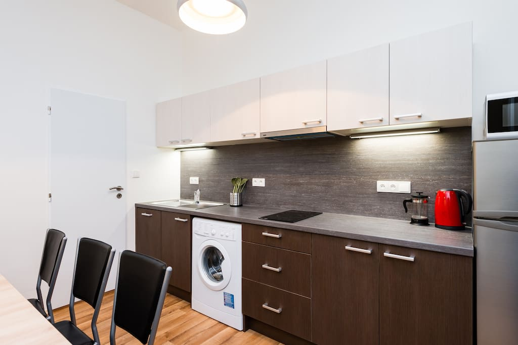 Fully equipped kitchen with dinning area.