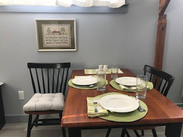 Dishware and serving set for up to 4 guests.