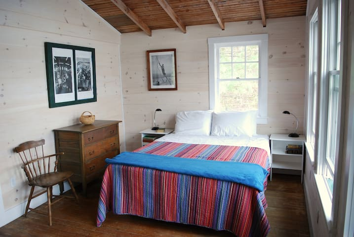 Bedroom with views of the lake on two sides