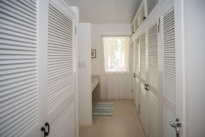 Ginger master bedroom large walk in closet with extra vanity. The large Ginger ensuite and walk in closet area has 2 separate vanity areas.
