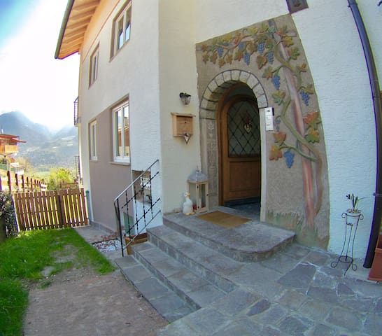 House main door and on the left the garden access gate