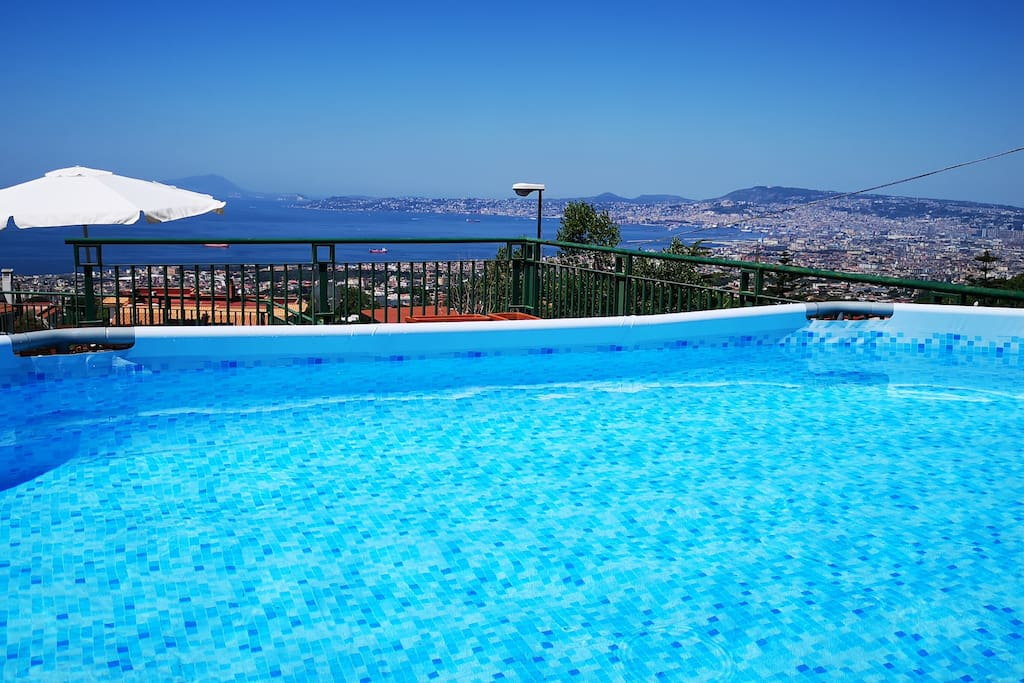 Private exclusive pool on the terrace with solarium and view of the bay of Naples, Sorrento Capri