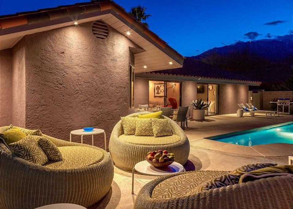 Curl up on wicker chairs for late night chats by the pool!