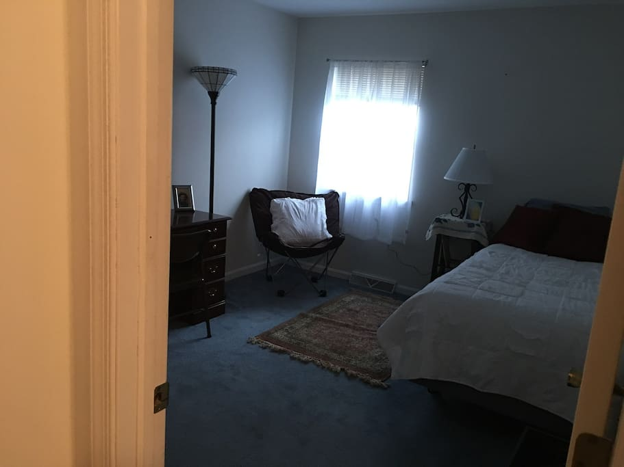 This is the private bedroom with a single twin bed, a comfortable chair, a desk, a chair for the desk and a closet with hangers. Your private bath is right across your bedroom.