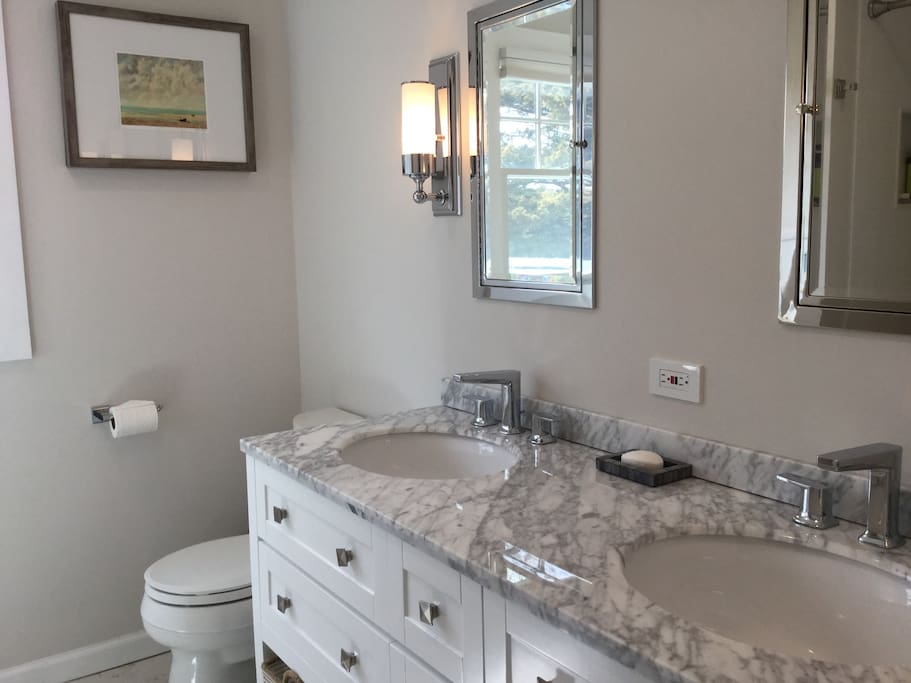 Full Bathroom, Double Vanity with Restoration Hardware Medicine Cabinets and Carrara stone Floor.