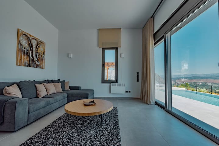 The very bright and comfortable, generously offering the stunning sea and mountain views with direct access to the beautiful private pool and garden of the residence living room.