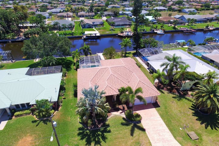 Located in desirable south east Cape Coral, this home invites you to live like the locals do, enjoying life on the Gulf access canal.