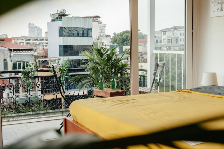 A cozy and spacious balcony where you can sit around and relax with your friends or your loved ones. From my personal experience, my favourite moment is when i wake up early in the morning and just looking out of the window onto the street.