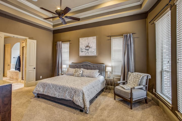 The master is its own retreat: King bed, 4K TV, sitting area, master bath, and walk in master closet.