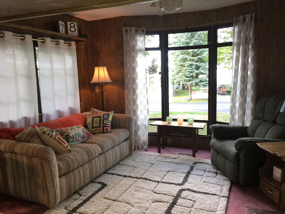 Sofa bed and large windows