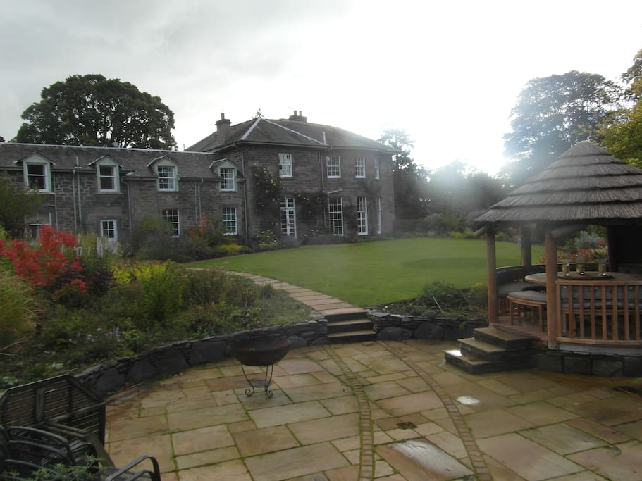 The house garden with gazebo and bbq