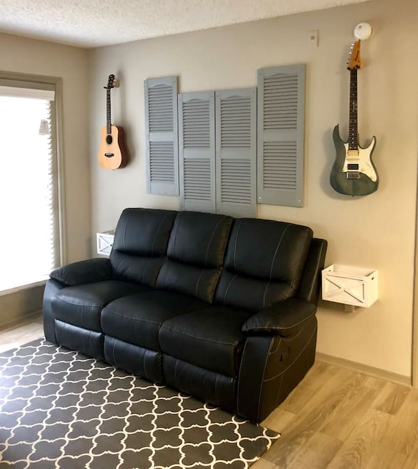 Living room with small patio outside  Reclining full grain leather sofa