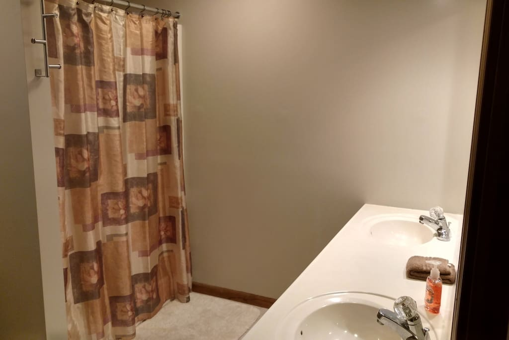 Private bathroom with shower and double vanity