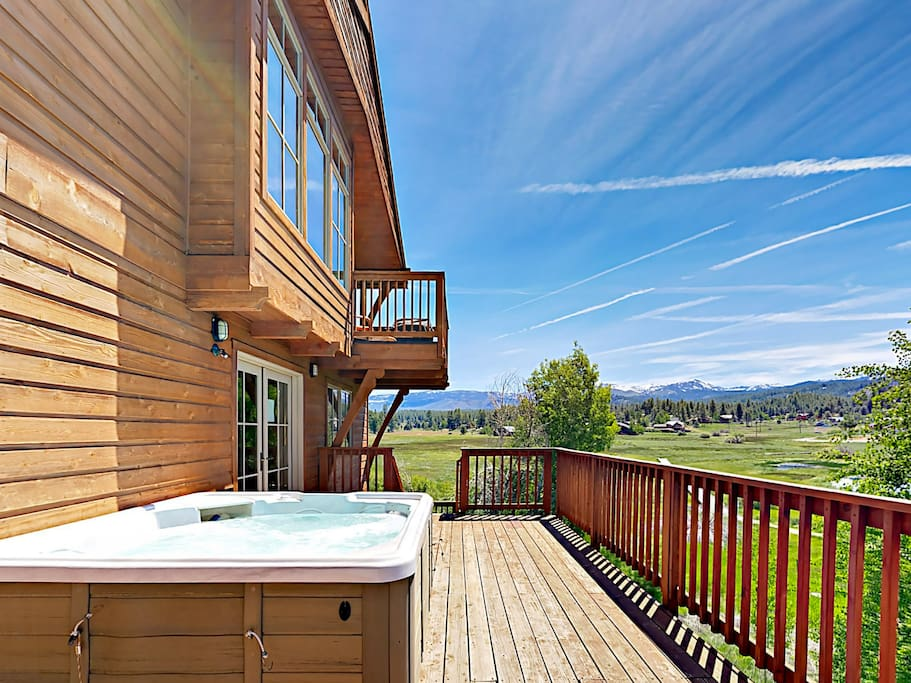 Soak in the hot tub overlooking the beautiful scenery.