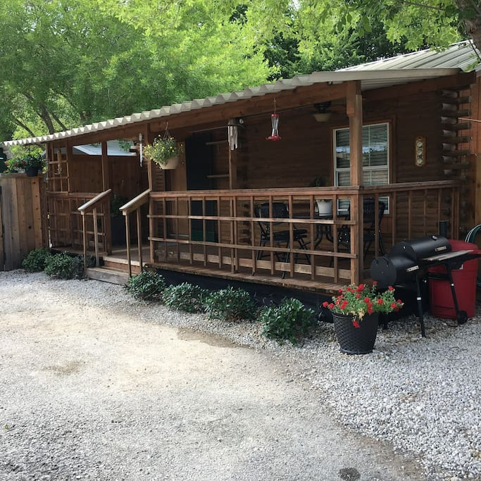 Front of cabin there is a nice shaded common area across the parking lot!