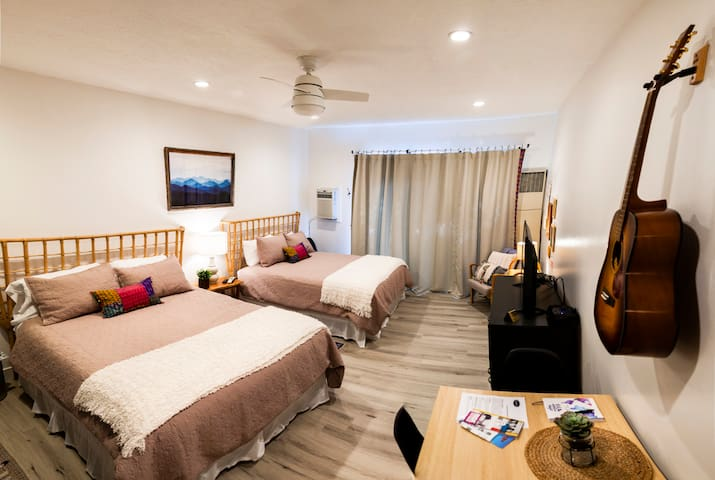 Spacious main room with 2 queen beds, an eat in kitchenette and plenty of room to spread out and relax.