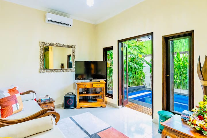 Fully air conditioned & very bright living room (3 seated sofa + 1 sofabed) connected together with the dining room and terrace.