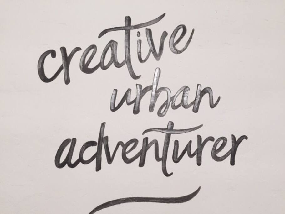 """we just love our """"Creative Urban Adventurer"""" sign... painted by our good friend and local artist Suzy Everson- we wanted to show it off!!!"""