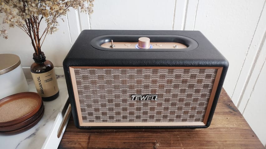 Hook up to our vintage Bluetooth speaker, or use the Aux cord to simply plug in and listen to all your favorite playlists!